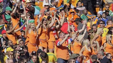 Some 36 women dressed up as Dutch supporters entered the stadium and stripped off their Dutch outfit to reveal the Orange miniskirt designed by Dutch beer brewer Bavaria.