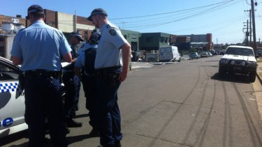 Police at the scene where a man was found injured at a brothel.