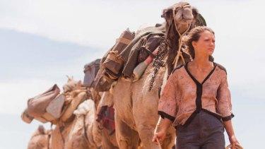 Mia Wasikowska plays Robyn Davidson in the Australian film <i>Tracks</i>.