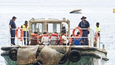 Asylum Seekers are transported to Christmas Island by barge.