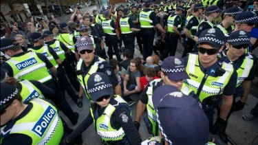 Police surround protesters on the Spring Street tram tracks.