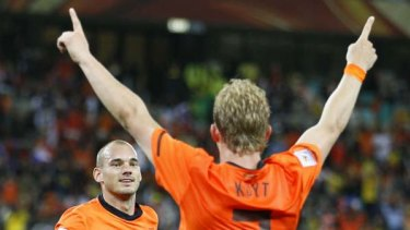 Netherlands' midfielder Wesley Sneijder runs up to striker Dirk Kuyt who provided him the cross to score the team's second goal.