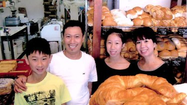 Local identities: Quan and Trinh Nguyen with their children Sophie and Kevin at the Vina Bakehouse in Wanniassa.