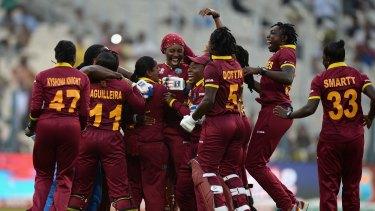 West Indies players celebrate winning the Women's ICC World Twenty20 final against Australia at Eden Gardens.
