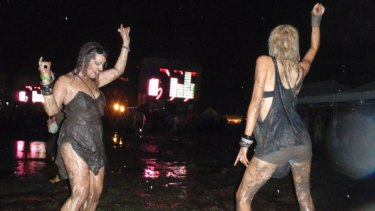 No stopping these party girl at a rain and mud saturated Future Music Festival.