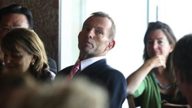 Man of the people? ... Tony Abbott at an International Women's Day event yesterday.