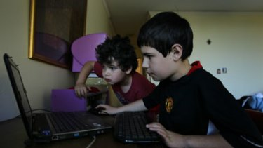Every move they make ... Daniel Suttner, 8, and his brother Guy, 10, playing online, helpless to stop various online companies from tracking their activities.