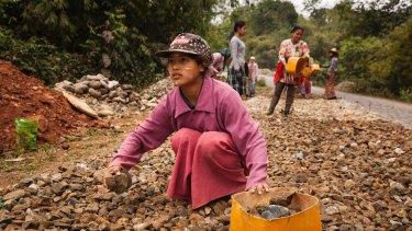 Rai Seng, 13, works for 4000 kyat (US$3.3) per day building and repairing roads in Kachin State, Myanmar.