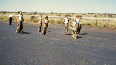 The sack race. Photo taken at the Wittenoom racecourse which was covered in asbestos tailings. Photo courtesy of the Asbestos Diseases Society of Australia Inc.