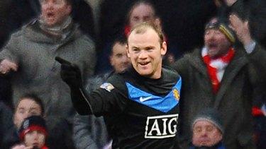 Wayne Rooney celebrates his goal against Arsenal