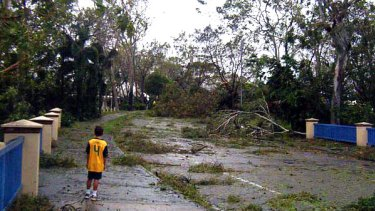 Boy inspects aftermath of Yasi in Townsville.