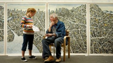 Jan Senbergs, pictured with granddaughter Isobel Long, has created an installation involving maps as part of the children?s art program at the National Gallery of Victoria?s Melbourne Now project.