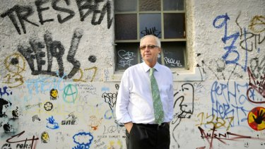 Municipal Association chief Rob Spence values the political and artistic merit of graffiti, such as the wall near his home, including a Banksy stencil work, bottom left.