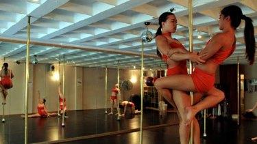 Assume the position … Spiral Rhythms' elite dancers make strenuous moves look effortless.