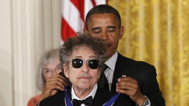 Barack Obama presents Bob Dylan with a Medal of Freedom in 2012.