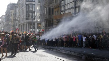 Turkish police use a water canon to disperse participants at Istanbul's Gay Pride parade.