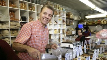 """Sam Vavasis working at the Dandenong Market nut stall his father began 36 years ago. """"I think multiculturalism works in Australia because we follow the rules a bit."""""""