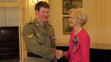 Governor-General Quentin Bryce presents Corporal Keighran with the Victoria Cross.
