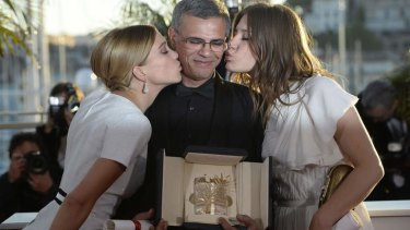 Lea Seydoux (left) and Adele Exarchopoulos (right) with winning director Abdellatif Kechiche.