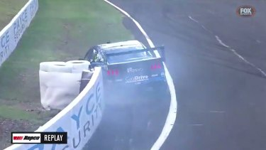 Tim Slade's car was seriously damaged in a huge crash at Bathurst that forced him out of the rest of the weekend
