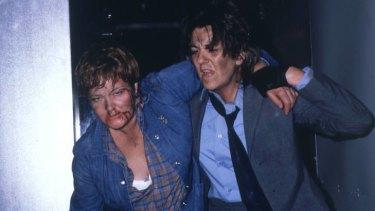 Queen Bea (Val Lehman) and the Freak (Maggie Kirkpatrick) in <i>Prisoner</i>.