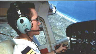Former Edith Cowan University aviation student Stephen Paul keeps an eagle eye out for sharks.