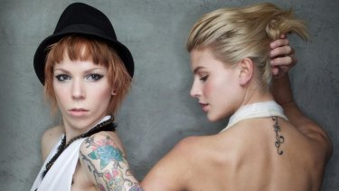 Tattoed models Souf (left) and Sophie (the face of Melbourne Spring Fashion Festival).