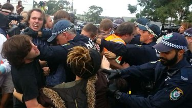 Police and protesters clash outside the Villawood detention centre.