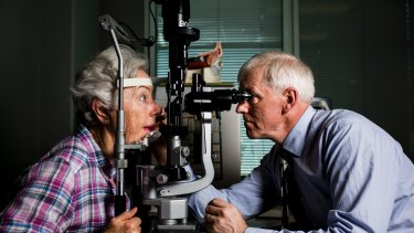 Optometrist Dr Mark Feltham with patient Patricia White of Bruce. The ACT has a shortage of new optometrists, according to the federal government. Photo: Jamila Toderas.