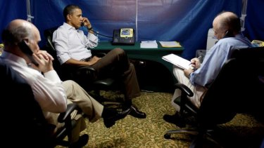 President Barack Obama is briefed on the uprising in Libya during a conference call inside a secure tent setup near his hotel suite in Rio de Janeiro, 2011.