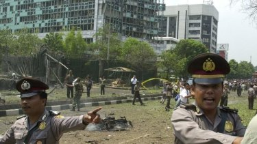 Indonesian police direct people near the embassy on September 9, 2004.