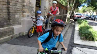 Bucking the trend … Saxon Dean, 6, his brother Griffin, 4, and their mother Jo leaving Bourke Street Public School yesterday.