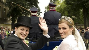 Prince Georg Friedrich of Prussia and Princess Sophie von Isenburg set off in a horse drawn carriage after their wedding ceremony in Potsdam.