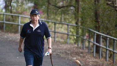 "Then Queensland Premier Peter Beattie takes his ""election winning"" dog Rusty for a walk in 2006."