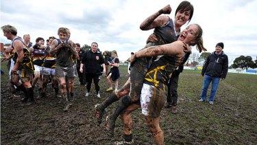 Glorious: Bendigo Thunder captain Emma Walters and Phoebe Smith celebrate their win in the mud wrestle against La Trobe.