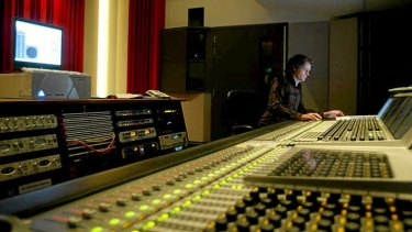 A recording and multimedia producer works the Sydney  Opera House studio.