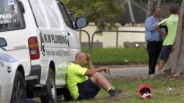 A colleague sits in shock after the fatal accident.