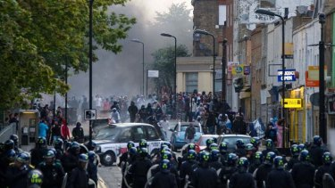 Stand-off ... riot police charge a mob in Hackney on Monday,  the third day of violent civil disorder in the capital.