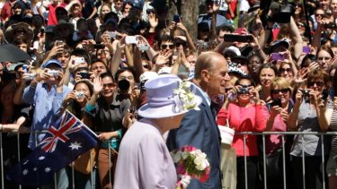 Monarchy rules ... the Queen and Prince Philip on parade in Canberra.