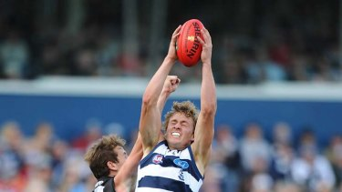 Geelong's Mitch Duncan stretches to take a mark.