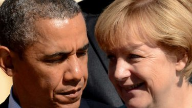 US President Barack Obama has been quizzed by German Chancellor Angela Merkel about whether her phone was tapped by US intelligence.