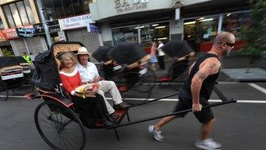 Sue Pace and Craig Davis on the Rickshaw Run through Footscray.