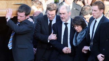 Dark days ... parents John and Marian Harte, with Michaela McAreavey's husband John, right, at her funeral.