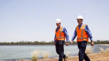 Arrow Vice President Exploration Tony Knight and Arrow CEO Andrew Faulkner at an Arrow dam in Moranbah.
