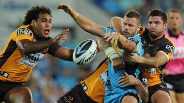 Hot potato: Sam Thaiday lunges for the ball after Aidan Sezer knocks on.