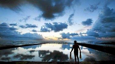 Chris Van Krevel takes an early morning dip in a pool on the Illawarra coast.