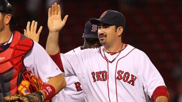 Adrian Gonzalez of the Boston Red Sox celebrates a 14-5 win over the San Diego Padres at Fenway Park on Tuesday. Josh Spence will play for the Padres in the second of the three-game series.