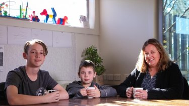 Aiden, 9, is already feeling the effects of hay fever on his asthma. He is pictured with his brother Patrick, 13, and mother, Belinda Smythe.
