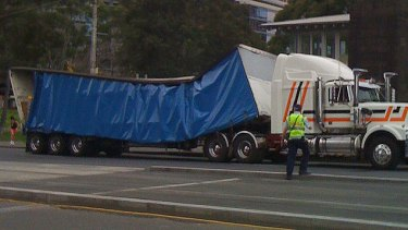 The load on the truck's trailer is pushed in at the centre.