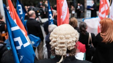 MELBOURNE, AUSTRALIA - MAY 17: Legal professionals from across the state are seen at a Rally For Legal Aid fundraiser outside the County Court of Victoria on May 17, 2016 in Melbourne, Australia. (Photo by Vince Caligiuri/Fairfax Media)